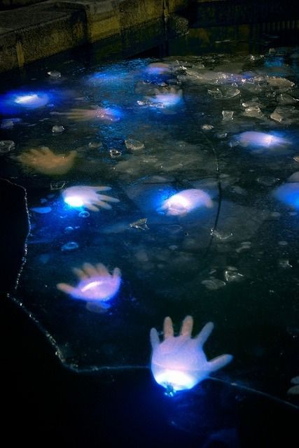 Halloween yard decorations - glowing hands