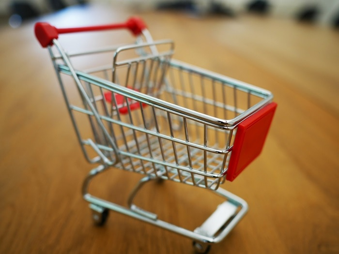 how to save money on groceries - cart